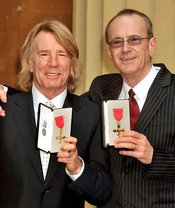 Rick Parfitt and Francis Rossi, founding members of British rock band Status Quo, with the OBE's in 2010