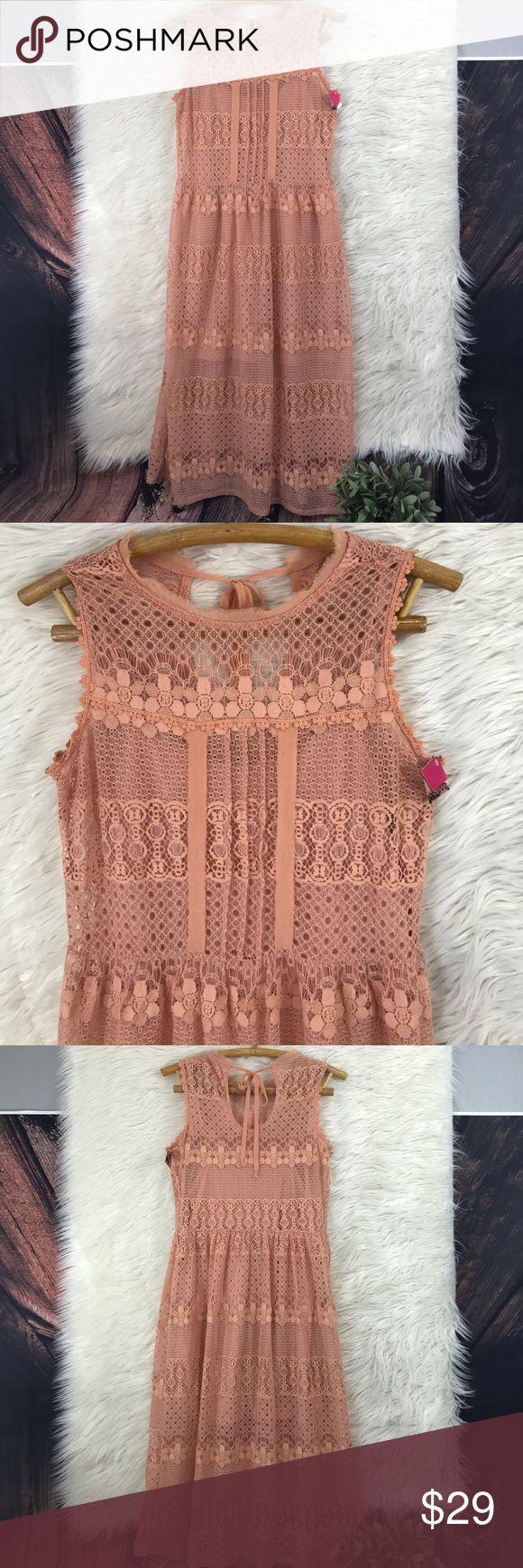 "NWT Target xhilaration peach lace boho dress NWT Gorgeous peach lace dress from Target xhilaration . Tie back. Size M 56% cotton 44% nylon. 45"" long Xhilaration Dresses"