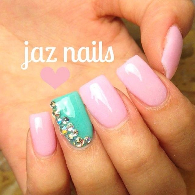 Pink and mint rhinestone nails.