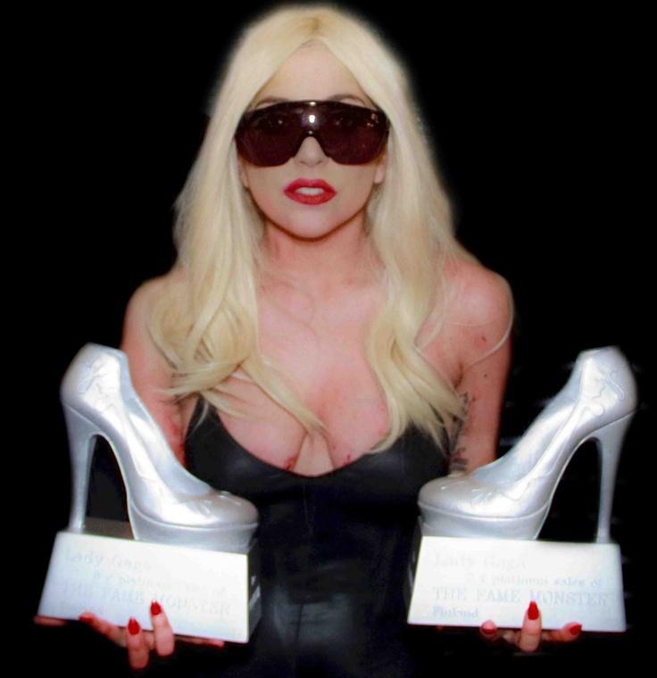 Lady Gaga with a Platinum Award designed by Minna Parikka.