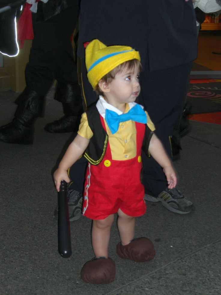 Pinnochio toddler costume: tie strings to his wrists and have dad hold them up