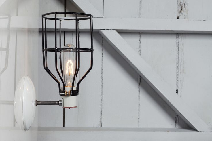Industrial Wall Light - Black Wire Cage Wall Sconce Light by IndLights on Etsy https://www.etsy.com/listing/161460112/industrial-wall-light-black-wire-cage
