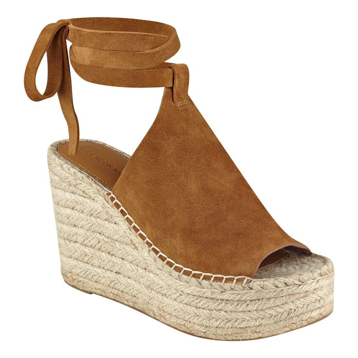 Casual wrap around platform wedge slide with braided jute sidewalls and rubber sole. // #SigersonMorrison