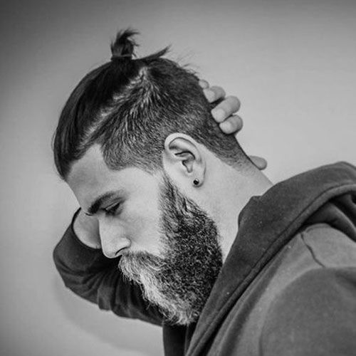 The top knot hairstyle for men, also known as the top knot bun, is a hybrid between the trendy undercut and man bun hairstyles. The men's top knot features faded sides with long hair on top combined with the tied up ponytail concept of the man bun. If you've already got an undercut, trying out the male …