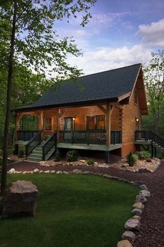 small log cabin in the woods, small log cabin, small log home, log homes, log home with porch, cozy log home, log home with black roof, Timberhaven log homes, engineered log homes, log home designs