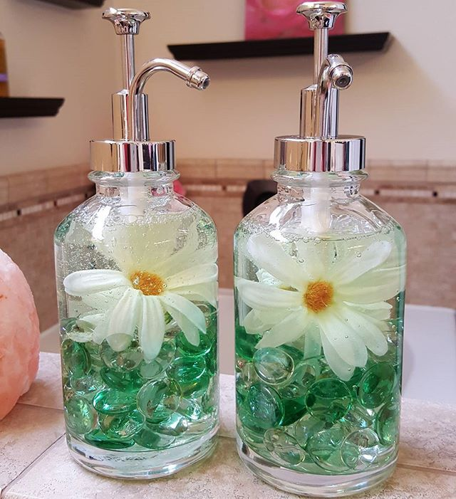 My daughter gave me these clear  handsoap glass dispensers for Christmas, and I had yet to do anything with them. ..how pretty are they now??? glass gems, flowers and softsoap handsoap all from the dollar tree!  dispensers from #target