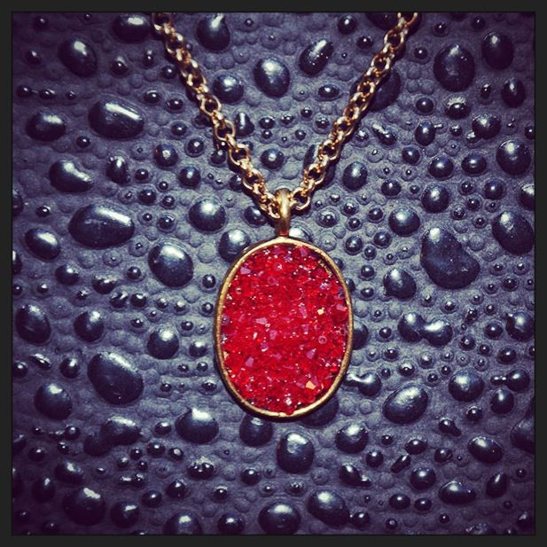 Smitten Designs red Swarovski crystal pendant with gold-plated chain. Available online at smittendesigns.ca or by special order (info@smittendesigns.ca) or at Fine Finds Boutique in Vancouver.