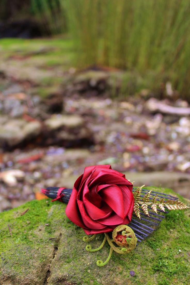 Red & black flax buttonhole with koru & fern.  www.flaxation.co.nz