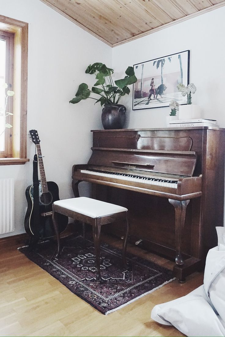 Empty room with chair violin and sheet music on floor photograph - Rug Under The Piano Bench And Plants Violin On Wall Along W Guitar Stool To Play Violin And Guitar But Keep Piano Bench