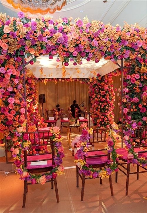 wedding inspiration, flowers, all things pink, pink flowers, real, fresh florals, floral pillar canopy, colorful, beautiful decorations, pink chairs