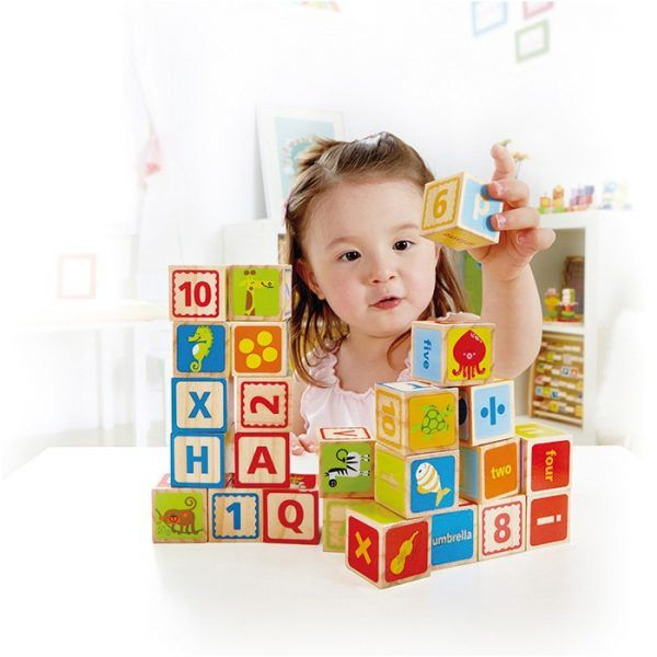 Letters, pictures and numbers inspire toddlers to create buildings, words and stories. Have your child immersed in the beauty of environmental print, making their own meaning from the letters and numbers around them.
