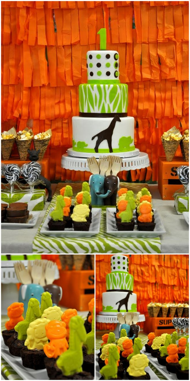 BRIGHT & COLORFUL SAFARI BIRTHDAY PARTY! THE CAKE OMG @Maria Soto Loucas look at the cupcake toppers!! Cute!!