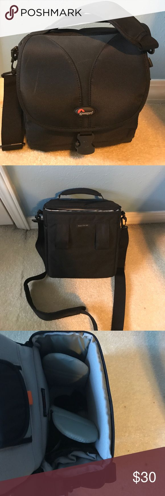 Black camera bag Black vinyl camera bag. I'm excellent condition. Never been used. 8.5 inches tall and 9 inches wide. 5 inches deep. Mini padded compartments. Bag includes shoulder strap. lowepro Bags Shoulder Bags