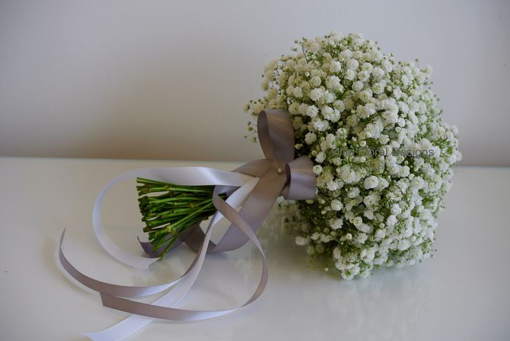 Gyp wedding bouquet, with long ribbons.