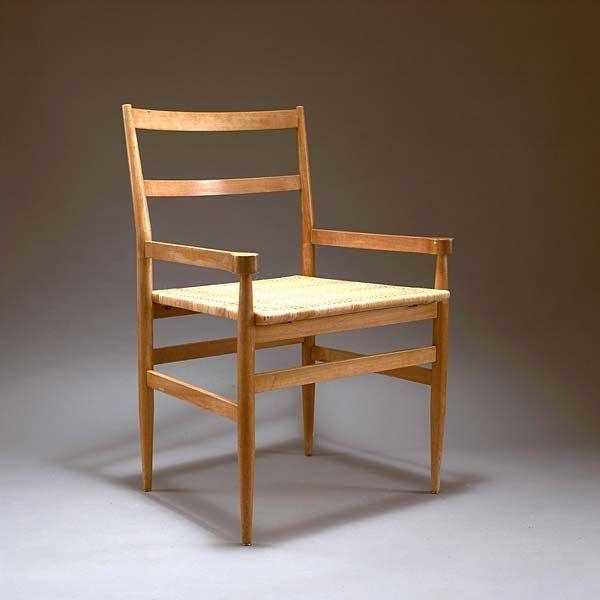 Gio Ponti; #1215 Walnut and Wicker Armchair for Knoll International, 1964.