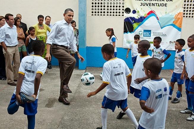 President Barack Obama plays soccer with children at the Cidade de Deus (City of God) favela Community Center in Rio de Janeiro, Brazil. March 20, 2011. (Official White House Photo by Pete Souza)