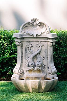 A wall fountain based on an original antique . Cast in GRC cement .