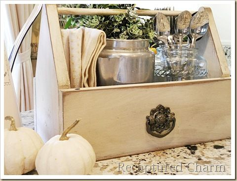 This gal is awesome....  Love this little caddy, repurposed from a child's craft box/caddy....