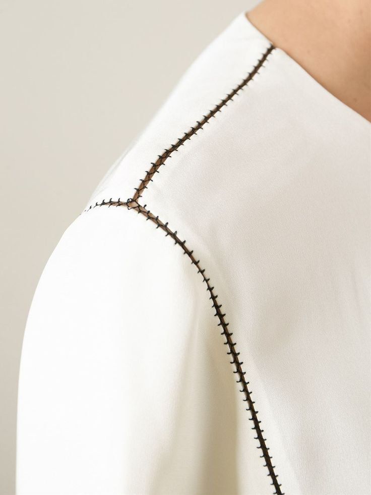 Panelled blouse with open stitch detail; sewing inspiration; close up fashion…