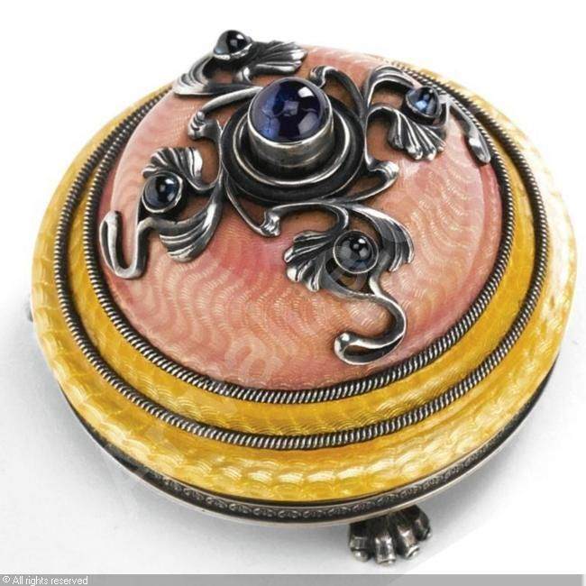 BELL PUSH sold by Sotheby's, London, on Tuesday, November 28, 2006  Wigstrom Henrik, Faberge 1903-1918(Finland) three silver feet, three silver rings and gold apink guilloche enamel with a silver design on top with a blue cabochon button