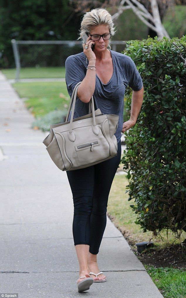 Chatter box: The blonde wore a pair of black leggings which she teamed with a baggy low cut grey T-shirt
