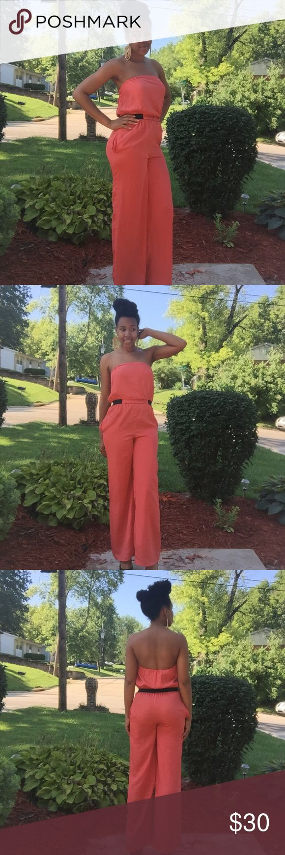 Coral Orange Jumper This coral/orange colored jumpsuit is so breezy and perfect for summer weather. Built in elastic band helps to cinch the waist for a more flattering fit. Pair it with flats during the day or jazz it up with heels at night! Xhilaration Pants Jumpsuits & Rompers