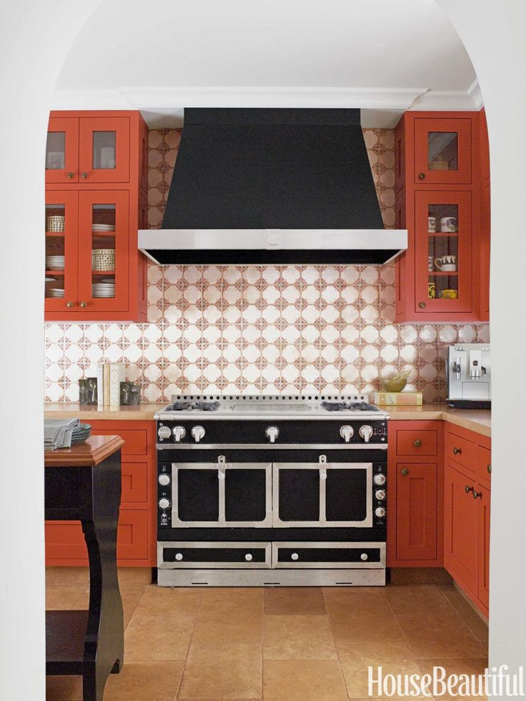 A liberal dose of spicy orange is what makes this California kitchen really special. Designer Melanie Coddington says it all started with the backsplash: Contessa Pagoda tile from Walker Zanger.