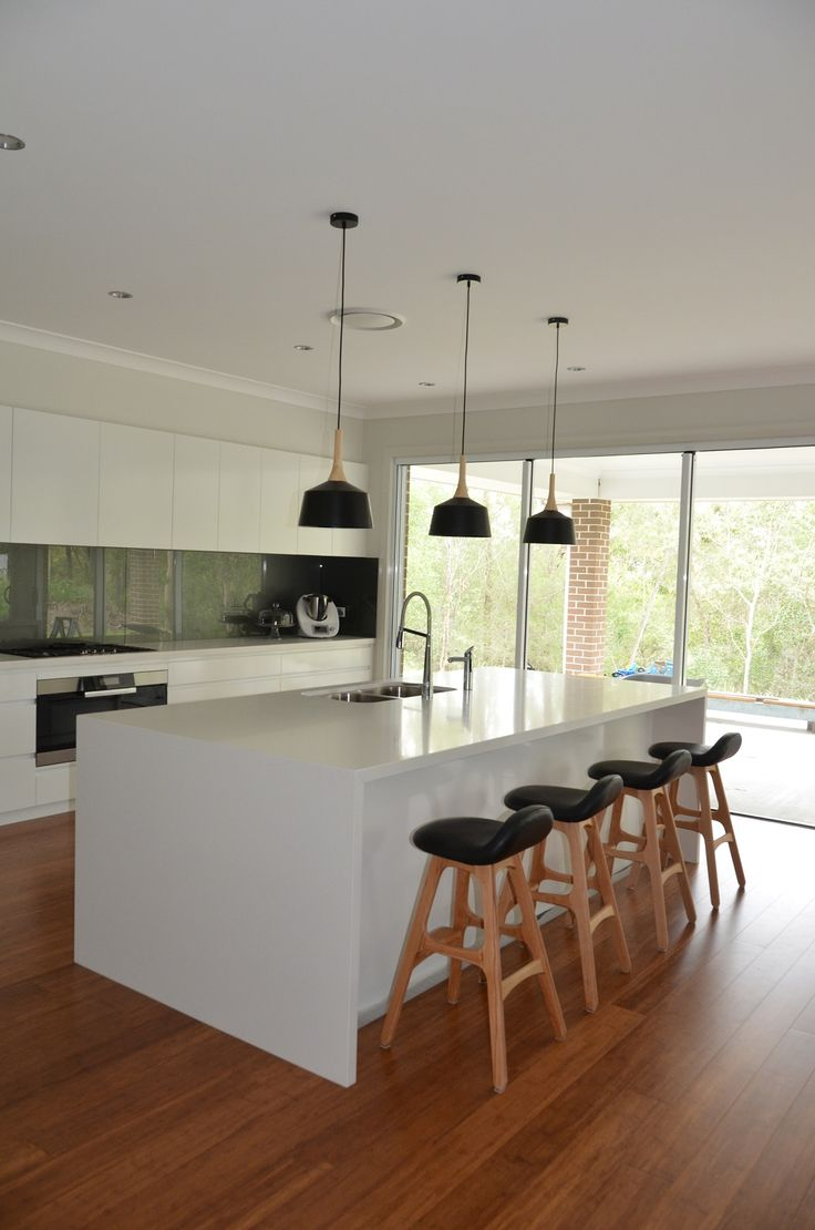 Nicole from the Brisbane area shares photos of her brand new Mornington acreage home (now called the Bronte). We love the kitchen decor Nicole has chosen, particularly those pendant lights! Discover Nicole's story at http://mcdonaldjoneshomes.com.au/about/latest-news/news/tranquil-qld-bushland-inspired-couples-journey. #kitchen #pendantlights #stools #hubofhome #newhome