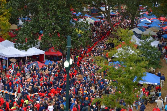 Ole Miss Football team walks through the Grove before the Arkansas game. Photo by Kevin Bain/Ole Miss Communications