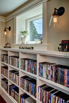 Lots of easily-visible DVD storage. Light-filled Basement - traditional - Basement - Seattle - Board and Vellum