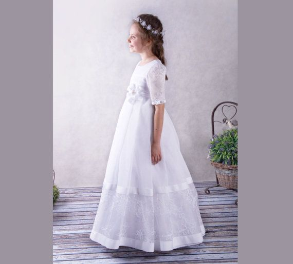FAST INTERNATIONAL SHIPPING: 2-5 AVERAGE DELIVERY TIME WITH DHL  The dress is made of delicate lace and voile noble. Active in a perfectly elegant style, girls and adorned with beautiful delicate flower-shaped brooch. Dress perfect for First Communion. Can be made in sizes from 116 cm tall (5-6 years old) to 146 cm tall (11-12 years old) With this dress can be ordered with shorter sleeves  SIZE EURO/CHEST cm /WAIST cm/ Length from shoulder cm 116/58-60/52-54/95 /SIZE US 6 122/60-62/56-58/101…