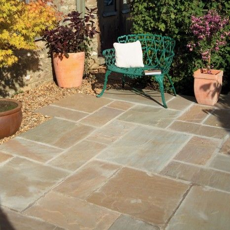 Sunset buff indian sandstone with a much nicer grey mortar. Gravel edging.