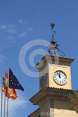 The tower clock on the building in the Palma de Mallorca. Mallorca, Spain
