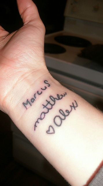 tattoo of childs name in child's handwriting... I like it!