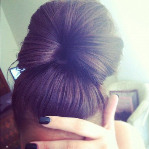 brown haired, scraped back huge bun