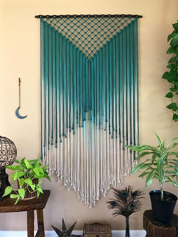 This extra large macrame wall hanging was made with hand dyed ombre teal cotton rope and hung from a welded chain. This unique piece is a true showstopper! Welded chain is 40, measures approx. 70 long. This item is ONE OF A KIND and READY TO SHIP! ✦ Shop NEW Teal Collection ✦