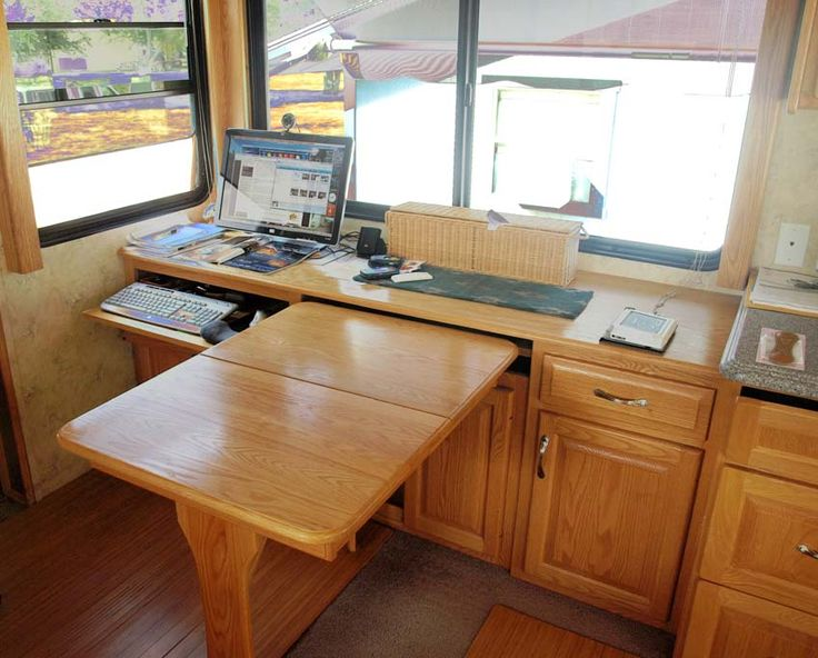 Check this out!  I love the idea of converting our 'booth' style table into an area that houses a desk with cabinets *and* has table potential!!  :)