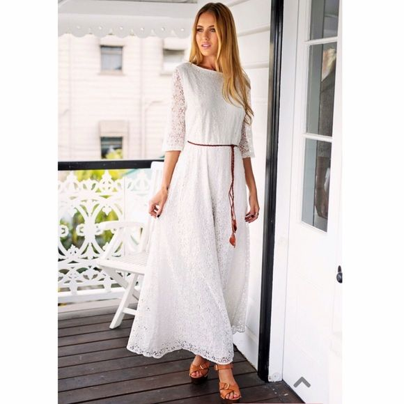 White Lace Maxi Dress with 3/4 sleeve size 8 This size 8 dress is even more beautiful in real life. It's new with tags. It's lace with three quarter sleeves. I ordered multiple sizes for a wedding I was in & can't return the one I didn't wear. Dresses Maxi