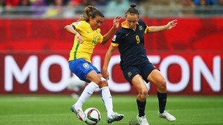 Marta of Brazil takes on Caitlin Foord of Australia