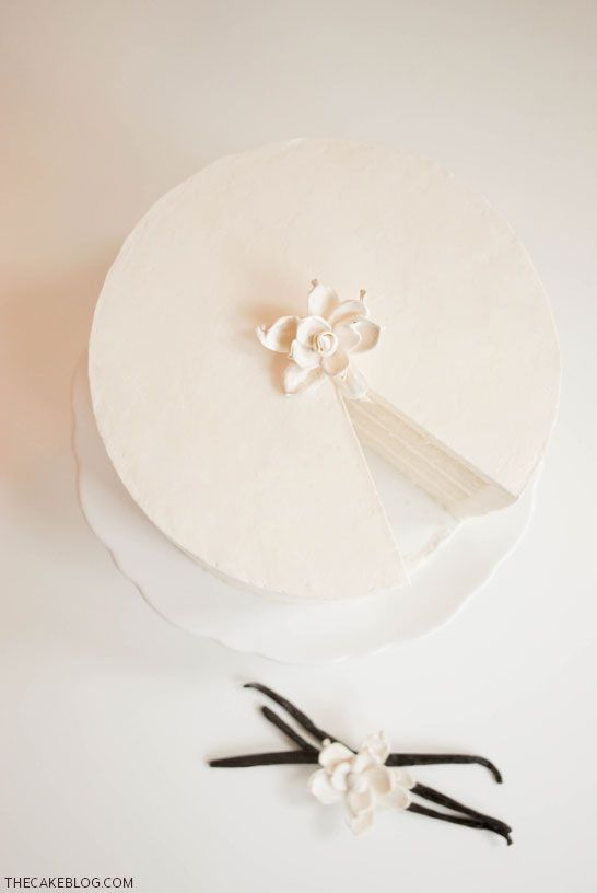 A classic vanilla cake recipe. Vanilla bean cake paired with vanilla Swiss meringue buttercream. Simple and delightful. A recipe by Carrie Sellman, editor of The Cake Blog.