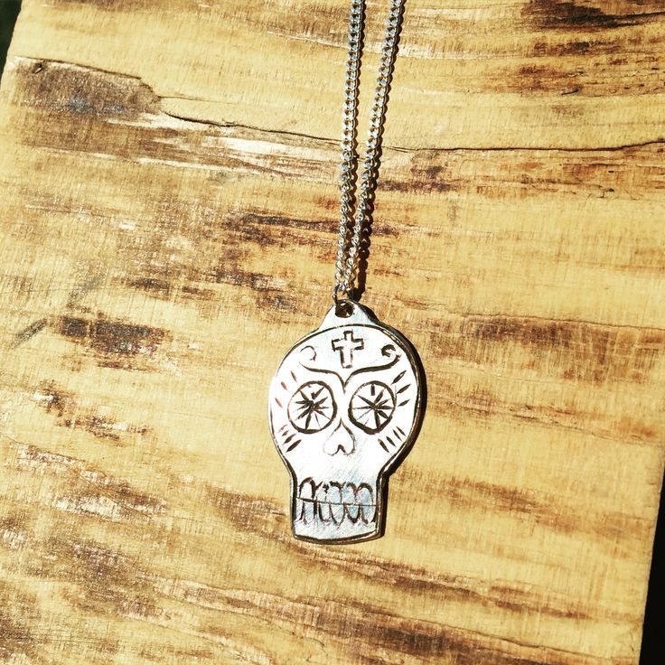 My hand-engraved sugar skull necklace. #sugarskull #engraved #skull #necklace