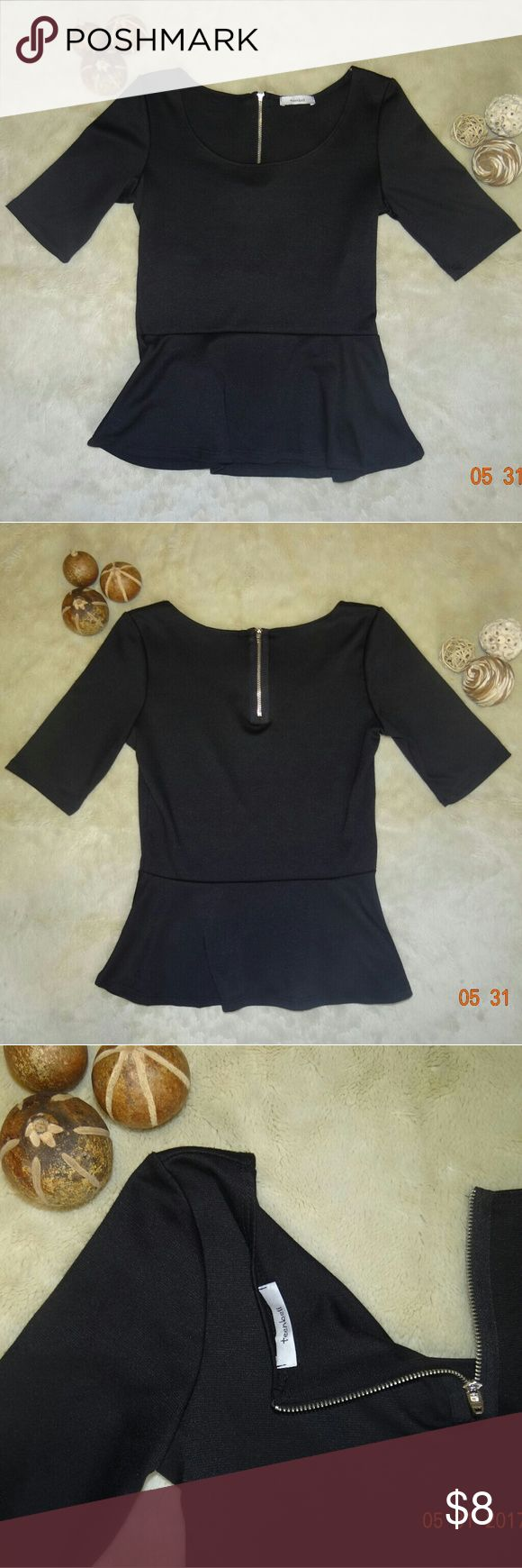 Black Peplum Top This item is used but still in good condition. Like new. Black peplum top brand teenbell in woman's size small. It has a back zipper closure. teenbell Tops