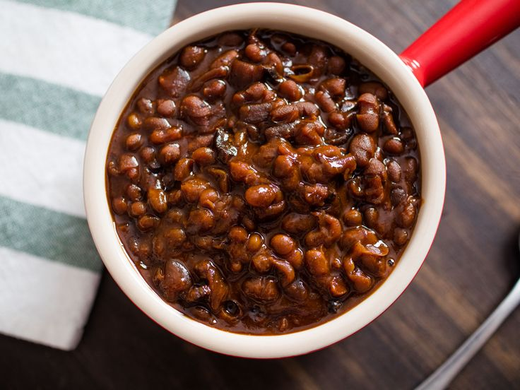 Boston baked beans, one of the most famous of many versions of baked beans to come out of New England, stars very few ingredients, the main ones being no more than beans, molasses, and salt pork. The secret is a long, slow cook in a dry oven to gently tenderize and partially break down the beans, while a deep, dark crust forms on top for the best possible flavor.