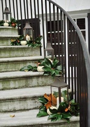 obsessed with this Southern staircase decorated with magnolia leaves