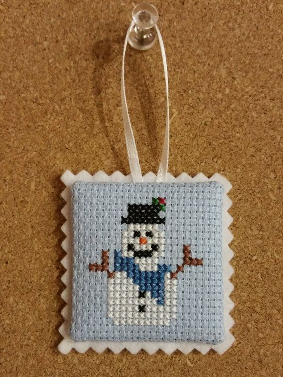 Adorable completed mini cross stich ornament, lovingly designed and made by me in my home.  Details: - snowman with a cute blue scarf and