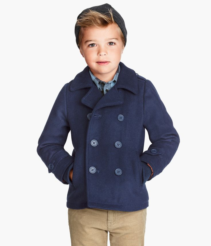 "The children's Place boys(or unisex) Navy wool thermolite double breasted Pea coat with quilted lining and anchor motif buttons. 21"" from top of shoulder to bottom edge of coat. 23"" from top of colla."