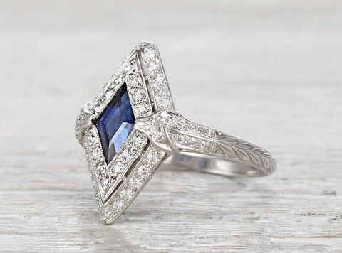 Antique Art Deco ring made in platinum and centered with an approximately 1.40 carat lozenge cut natural sapphire. Circa 1920.