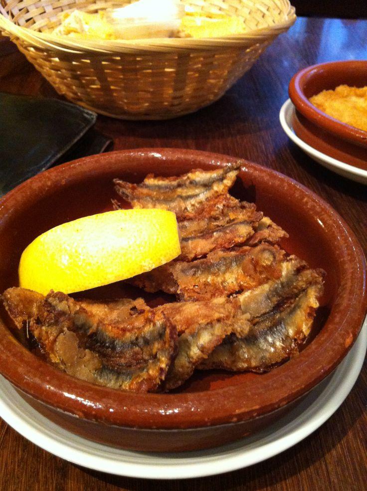 In my favorite Tapas bar: fried sardines!
