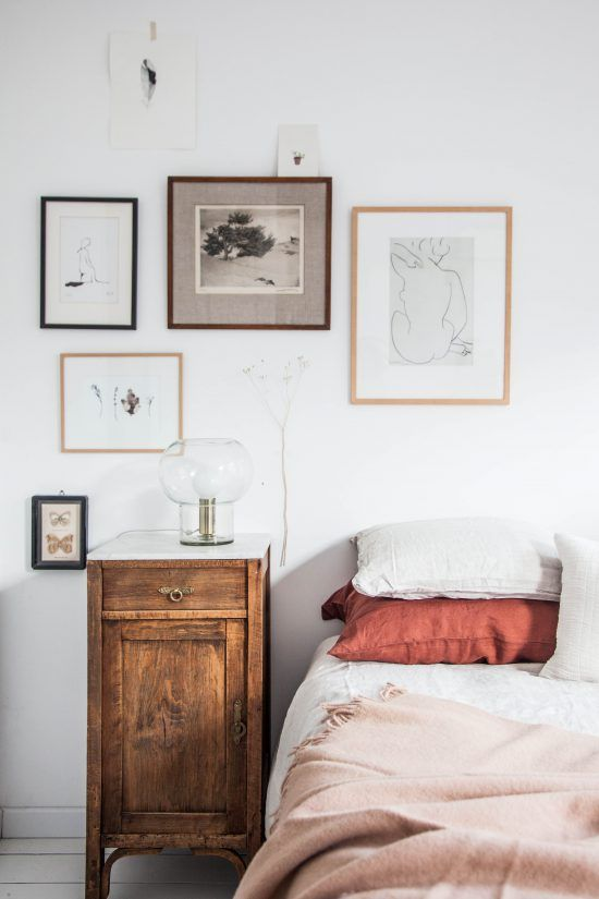 small gallery wall next to the bed and the mushroom lamp from @Housedoctor
