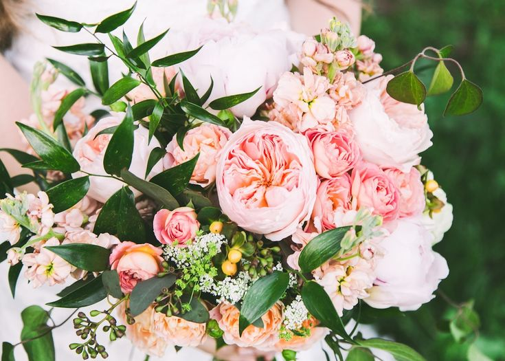 the greenery in this and i love the blush garden roses